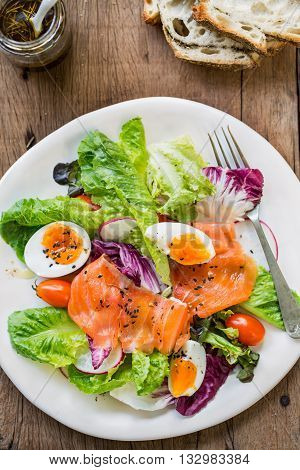Smoked Salmon with boiled eggs salad by some bread