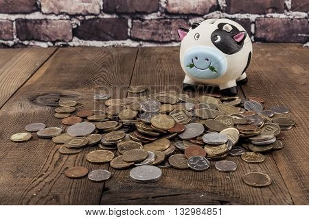 Piggy Bank On Wood Table