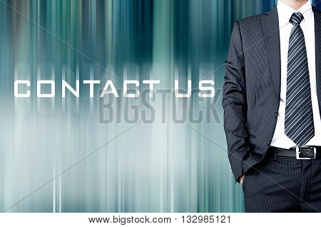 Contact Us Sign On Motion Blur Abstract Background With Standing Businessman