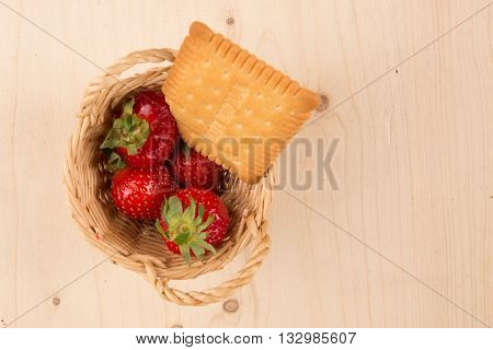 Strawberries Filling A Small Basket On Wooden Background, Flat Lay