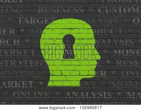 Marketing concept: Painted green Head With Keyhole icon on Black Brick wall background with  Tag Cloud