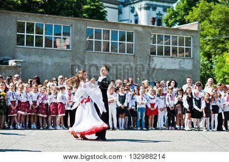 Bila, Ukraine - May 27, 2016: School Line Is In Schoolyard With First-grade Pupils And Teacher. Scho