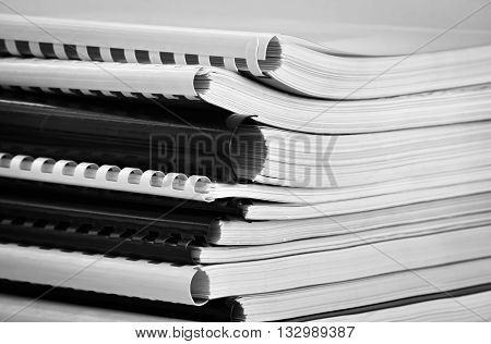 Closeup of several printed books in black and white colors