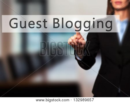 Guest Blogging - Businesswoman Hand Pressing Button On Touch Screen Interface.