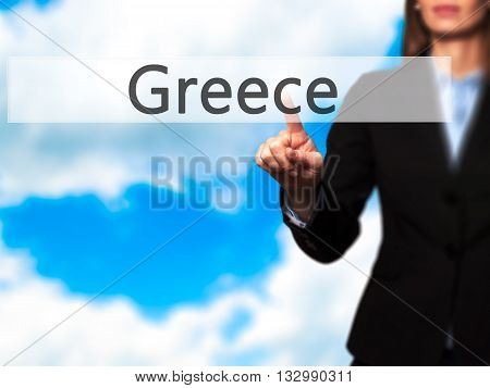 Greece - Businesswoman Hand Pressing Button On Touch Screen Interface.