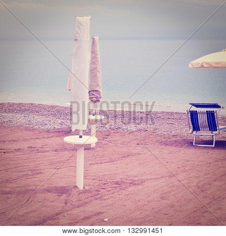Beach Umbrella and Sun Bed in the Sandy Coast near the Italian City of Minori Retro Effect