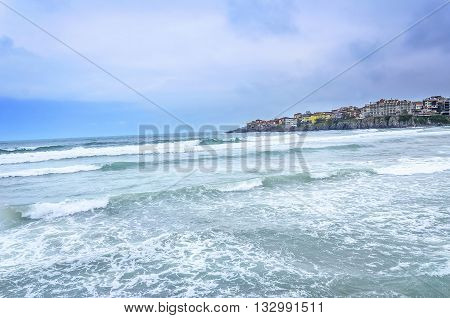 Sea waves on a background of the built-up of shoreline.