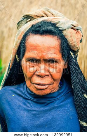 Frowning Woman With Headcloth In Indonesia