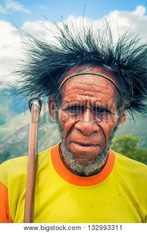 Frowning Man With Axe In Indonesia