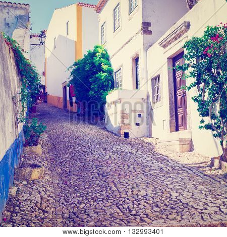 Narrow Street in the Medieval Portuguese City of Obidos Retro  Effect
