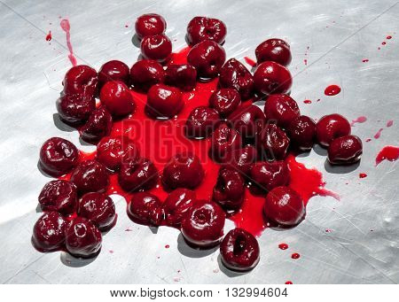 Splashed sour cherries on metallic surface sour cherry fruits pattern