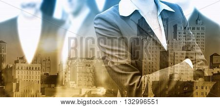 double exposure of group of businesspeople and cityscape