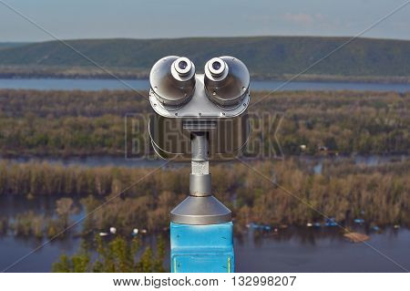 Binoculars public on the high bank of the Volga River.