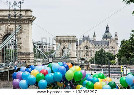 Famous Chain bridge Saint Stephen's basilica and colorful balloons in Budapest Hungary. Cultural heritage. Entertainment event. Travel destination. Famous place. Tourism theme. Vibrant colors. Architectural theme.