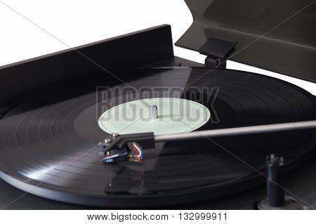 HIFI turntable playing black vinyl record closeup