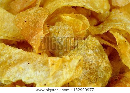 Detail of fried spicy tasty potato chips