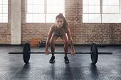Female Performing Deadlift Exercise With Weight Bar poster
