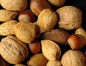 picture of nutter  - various assorted nuts on a black background  - JPG