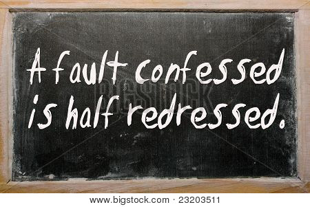 """a Fault Confessed Is Half Redressed"" Written On A Blackboard"