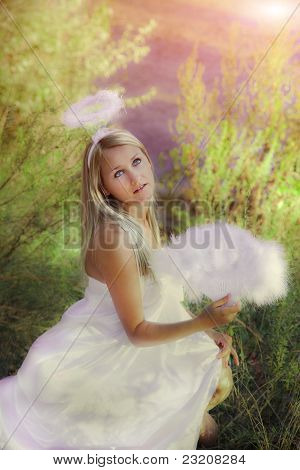Beautiful Angel Girl In Forest