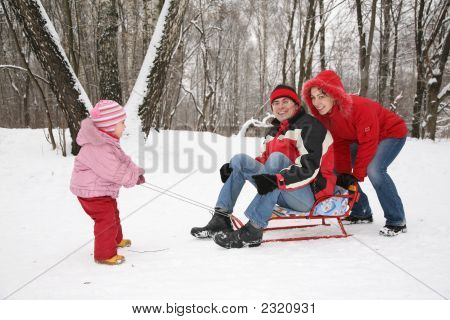 Winter Family On Sled