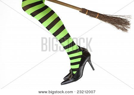 Witch's legs and a broomstick.