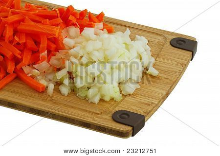 Chopped Carrot And Onion On Bamboo Cutting Board Isolated On White