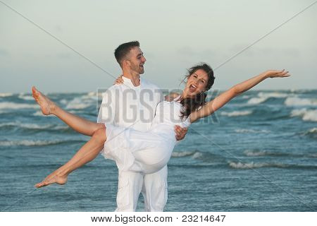 Happy Man Holding Smiling Woman