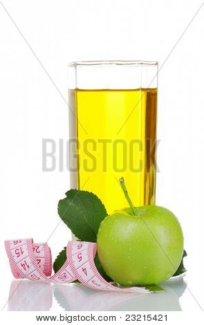 Glass of fresh apple juice with measuring tape isolated on white