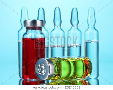medical ampoules on blue background