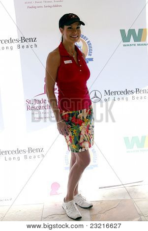 MOORPARK, CA - AUG. 29: Paula Trickey arrives at the 4th annual Scott Medlock-Robby Krieger Concert & Golf Classic on Aug. 29, 2011 at the Moorpark Country Club in Moorpark, California.