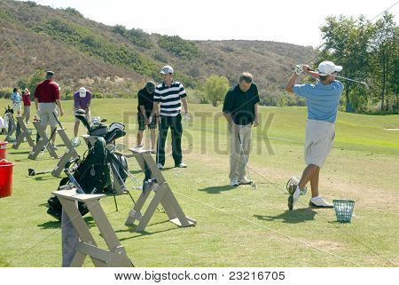 MOORPARK, CA - AUG. 29: Jeremy Sumpter (striped shirt) practices at the 4th annual Scott Medlock-Robby Krieger Concert & Golf Classic on Aug. 29, 2011 at Moorpark Country Club in Moorpark, California.