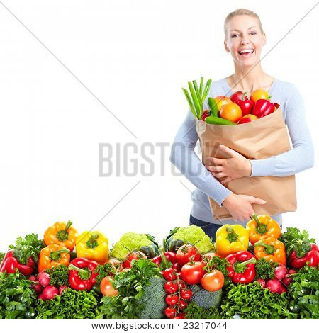 Happy young woman with vegetables. Isolated over white.
