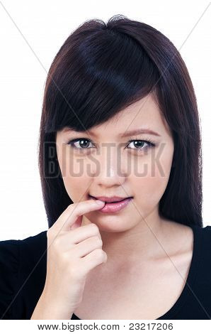 Cute Young Asian Woman Biting Her Finger
