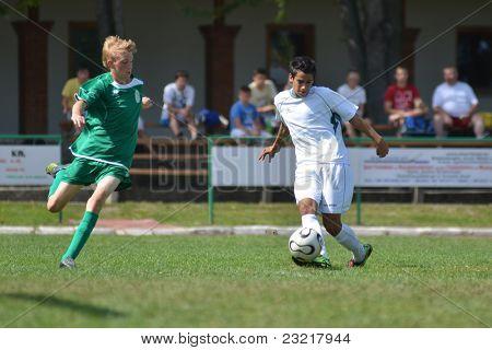 KAPOSVAR, HUNGARY - SEPTEMBER 5: Unidentified players in action at the Hungarian National Championship under 17 game Kaposvar (white) vs. Nagyatad (green) September 5, 2011 in Kaposvar, Hungary.