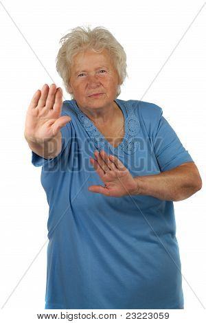 Senior Woman Is Making Stop Gesture , On White Background