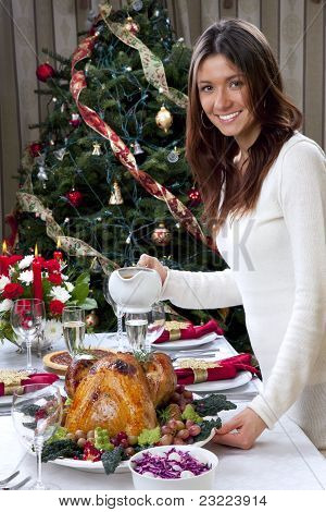 Woman Christmas Dinner Roasted Turkey