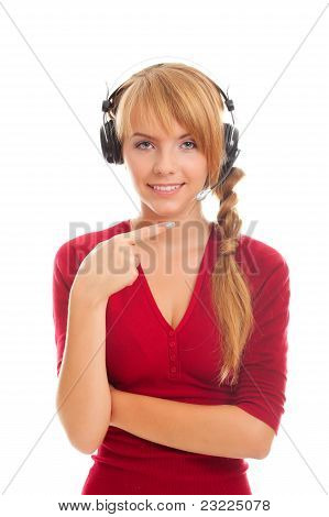 Young Woman Help Line Operator In Headphones And Points At The Microphone