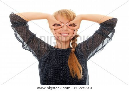 Pretty Young Woman Looks Through Her Fingers