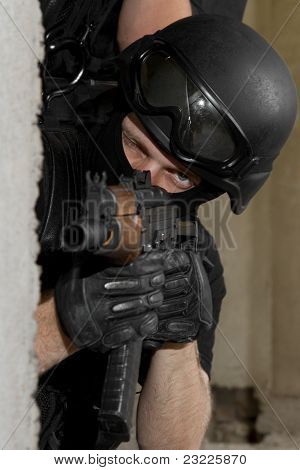 Soldier In Black Mask Targeting With Ak-47 Rifle From Cover
