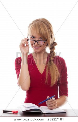 Girl Teenager With Textbook And Pen In Glasses