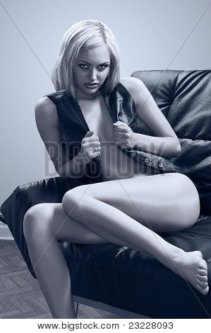 Blond Girl On Black Sofa