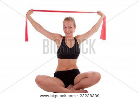 A Young Woman With A Stretch Band