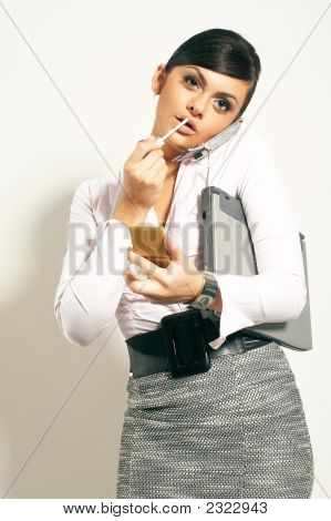 Atractive Brunet Businesswoman With Lipstic, Phone Looking On Clock