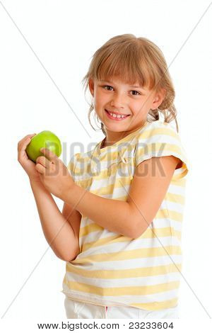 Schoolgirl portrait holding green apple isolated