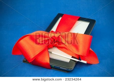 Electronic book reader tied up with red ribbon