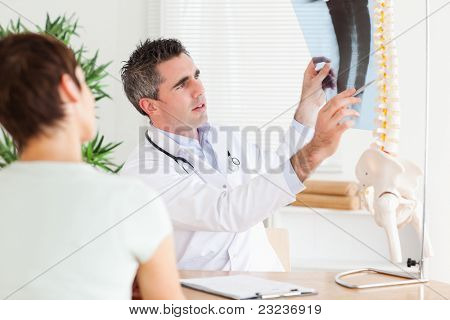 Male Doctor showing a patient a x-ray in a room