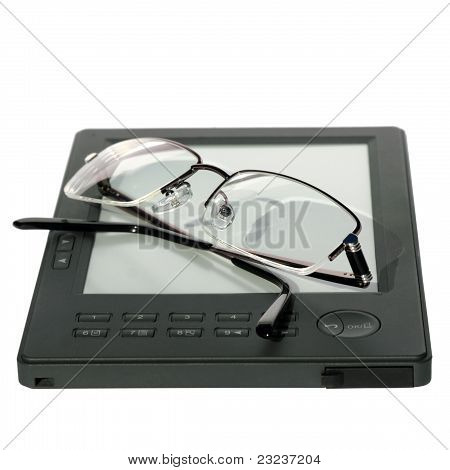 Glasses Lying On The E-book