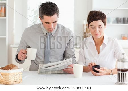 A cute couple is preparing for work at breakfast