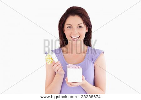 Charming woman opening a box in a studio